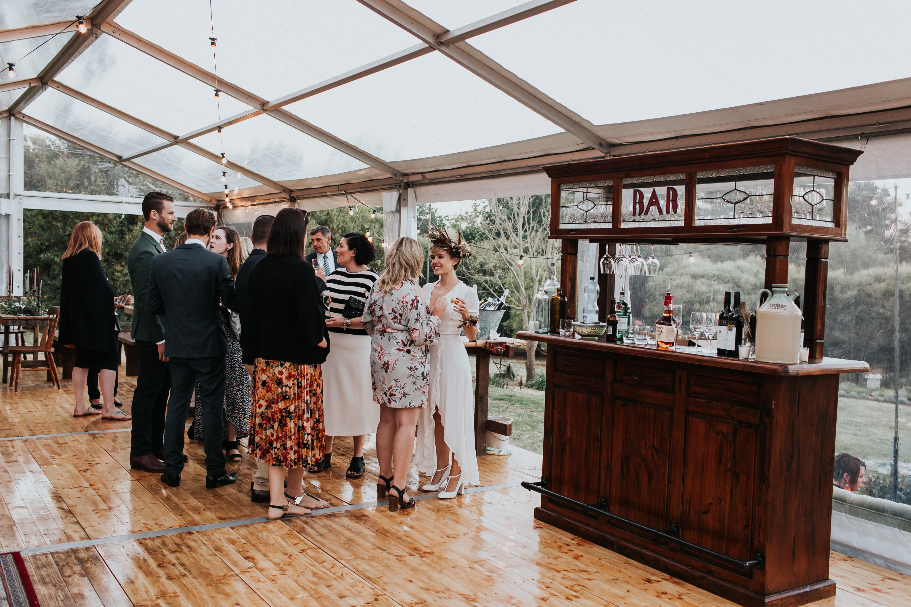 Antique bar in marquee backyard wedding