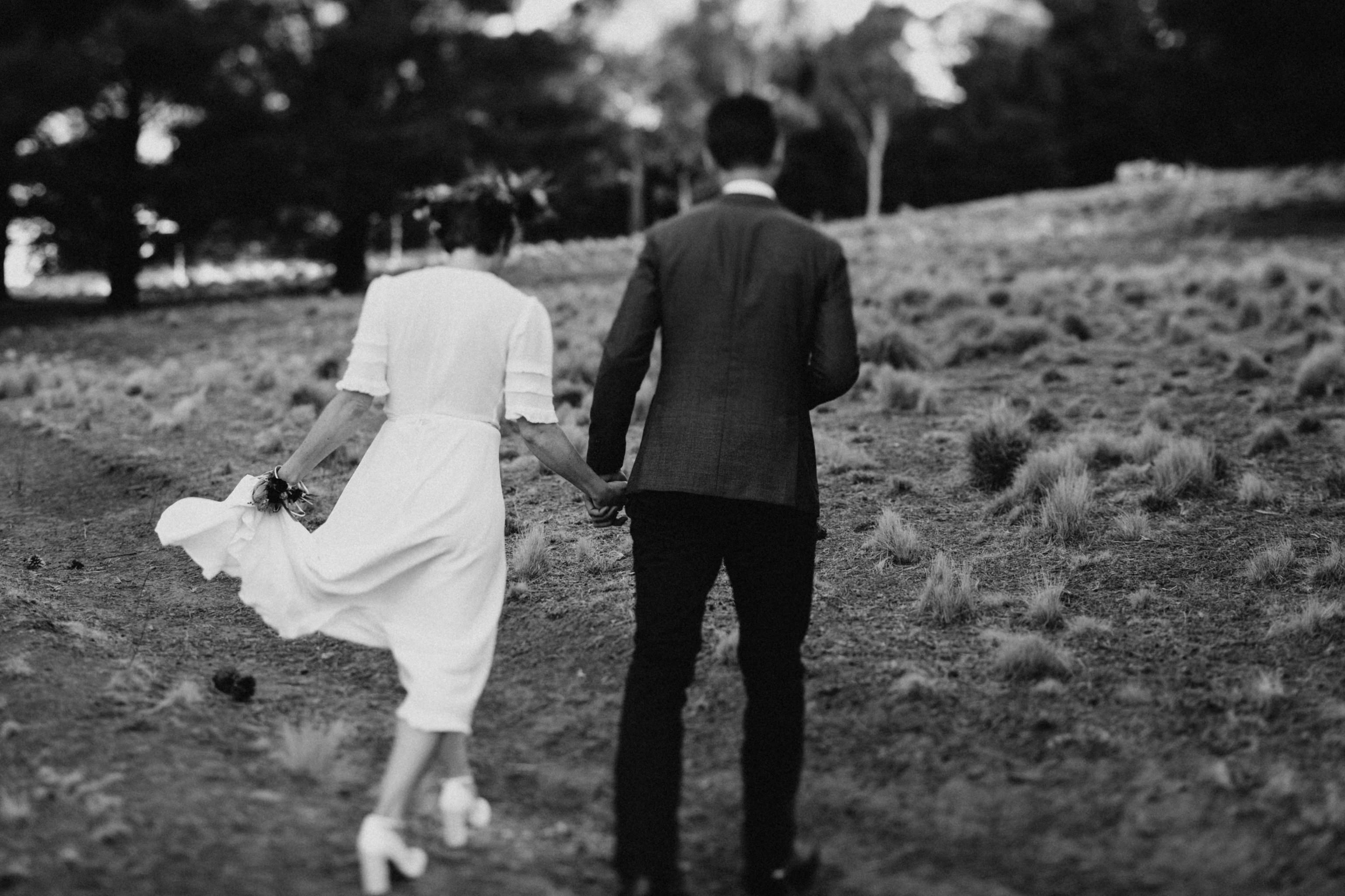 Black and white tilt shift bride and groom walking